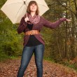 Girl wants to know if its raining — Stock Photo #35502063