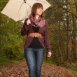 Girl is enjoying the view with an umbrella — Stock Photo