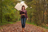 Walking with an umbrella — Stock Photo