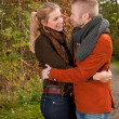Happy lovers in the autumn — Stock Photo