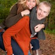 Happy young couple in the autumn — Stock Photo