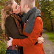 Kissing in the sunny autumn — Stock Photo