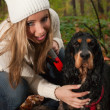 Blond girl and her dog — Stock Photo
