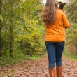 Walking back in the forest with a dog — Stock Photo