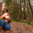 Happy girl and her dog — Stock Photo