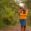Walking and smiling with the dog — Stock Photo
