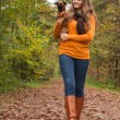Walking in the forest with the dog — Stock Photo