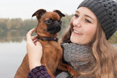 Sweet winter teenager and her dog — Stock Photo