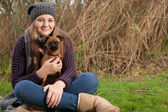 Sitting on the grass with my dog — Stock Photo