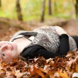 Smiling pregnant woman in the forest — Stock Photo #41977785