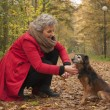 Stock Photo: Retired womis caring of her dog