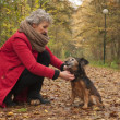 Stock Photo: Ager womand her dog