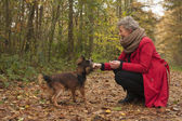 Retired woman and her dog — Stock Photo