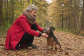 Ager woman and her dog — Stock Photo