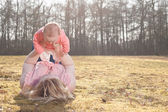 Mother and baby in the field — Stock Photo
