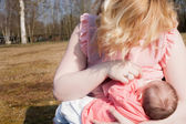 Mother is giving her baby breastfeeding — Stock Photo