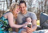 Young family is smiling while taking a selfie — Stock Photo