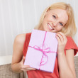 Beautiful young woman with her present — Stock Photo #12409240