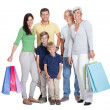 Happy generations family with shopping bags — Stock Photo