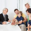 Stock Photo: Family in real-estate agency