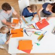 Young family drawing with colorful pencils — Stock fotografie