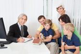 Family in real-estate agency — Stock Photo