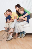 Young family playing videogames — Stock Photo