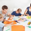 Young family drawing with colorful pencils — Stock Photo