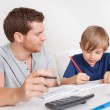 Young boy doing homework — Stock Photo #12440004