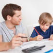 Stock Photo: Young boy doing homework