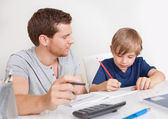 Young boy doing homework — Stockfoto