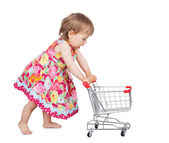 Little girl pushing a trolley — Stok fotoğraf