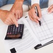 Excited middle-aged couple doing finances at home — Stock Photo #12720144
