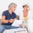 Senior couple discussing a document — Stock Photo #12720125