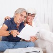 Excited middle-aged couple reading document — Stock Photo #12720137