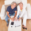Excited middle-aged couple doing finances at home — Stock Photo #12720150