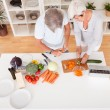 Middle-aged couple preparing a meal — Stock Photo