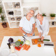 Middle-aged couple preparing a meal — Stock Photo #12720242
