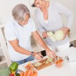 Middle-aged couple preparing a meal — Stock Photo #12720253