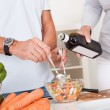 Middle-aged couple preparing a meal — Stock Photo #12720272