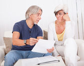 Senior couple discussing a document — Stock Photo