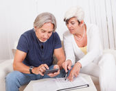 Senior couple doing their finances — Stock Photo