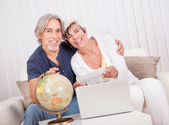 Ecstatic couple displaying holiday tickets — Stock Photo