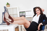 Young Businesswoman Relaxing In Office — Stock Photo