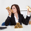 Businesswoman Holding Gold Bar — Stock Photo #12751777