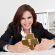 Businesswoman Holding Gold Bar — Stock Photo