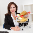 Businesswoman Presenting Gold Bars — Lizenzfreies Foto