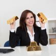 Businesswoman Holding Gold Bar — Stock Photo #12751927
