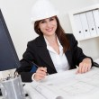 Businesswoman In Hardhat With Blueprints — Stock Photo #12752117