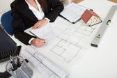 Closeup Of Architect Working On Blueprint — Stock Photo